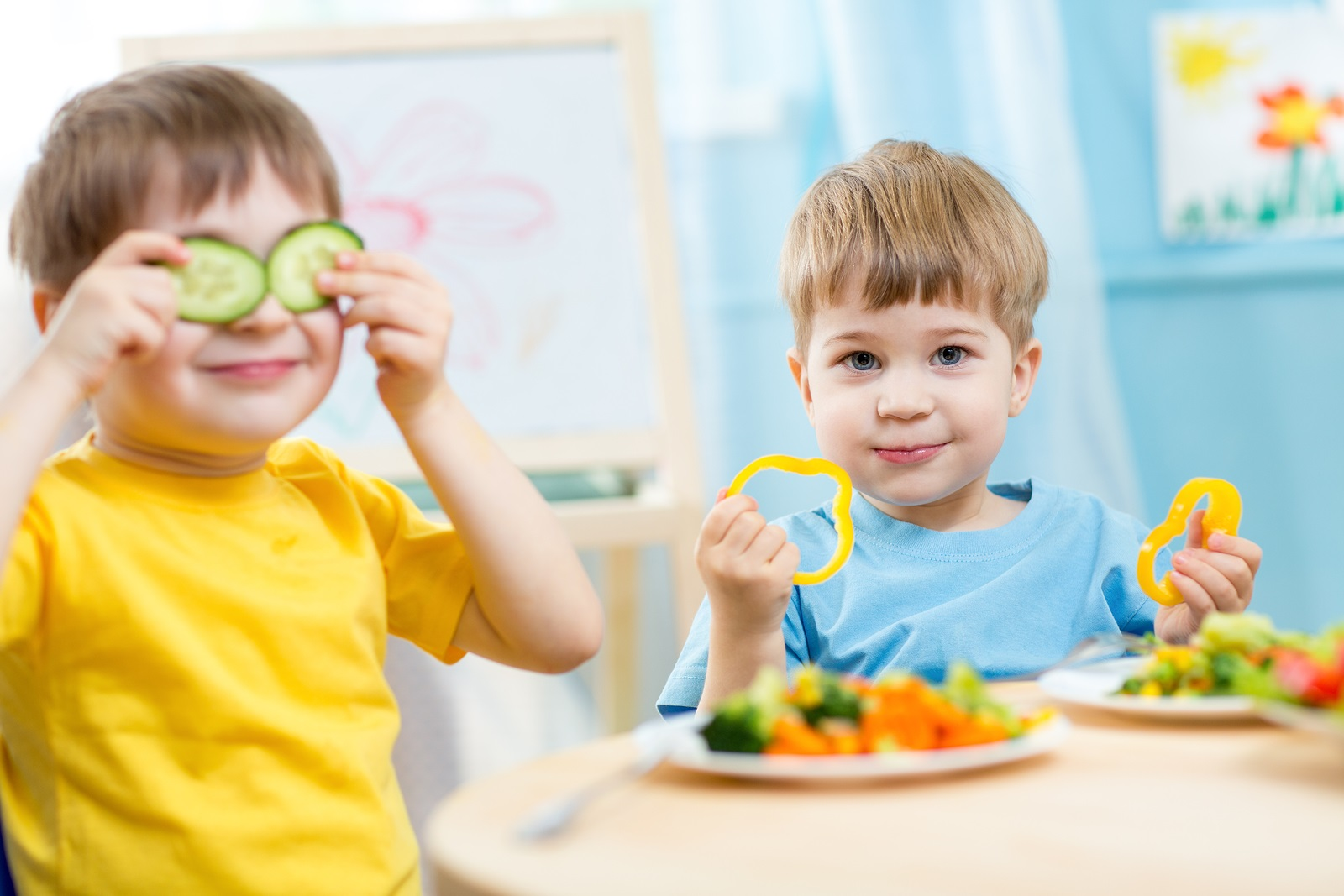 kids eating healthy food in kindergarten or at home